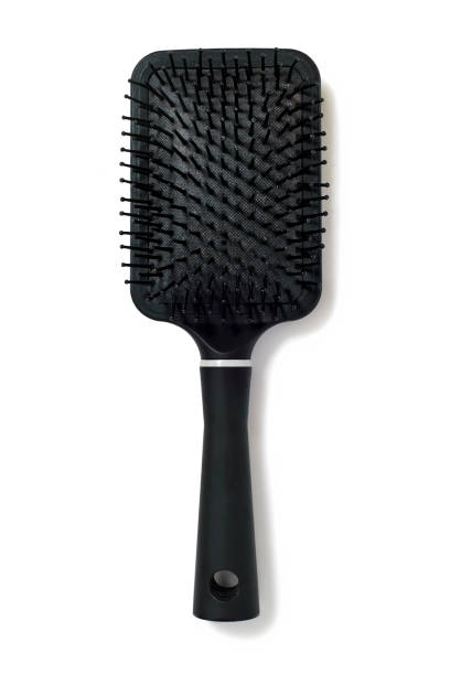 Overhead photograph of black plastic hairbrush isolated on white background stock photo