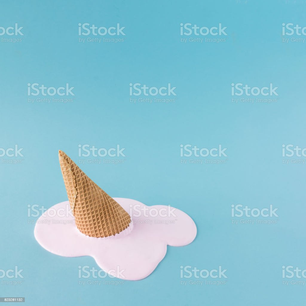 Overhead pink ice cream on pastel blue background. Minimalistic...