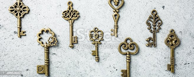 istock Overhead shoot of many different old keys 1148853652