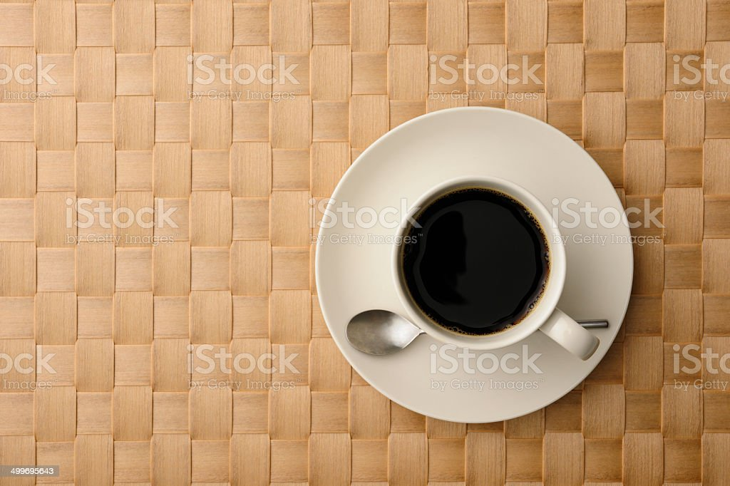 Overhead shot of a cup of coffee on place mat royalty-free stock photo