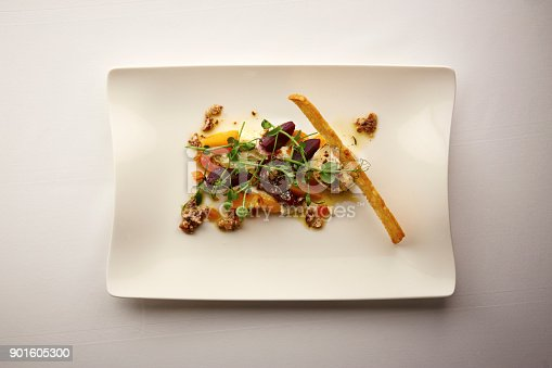 Directly above photograph of a stylish Nouvelle Cuisine plate of beetroot and walnut salad