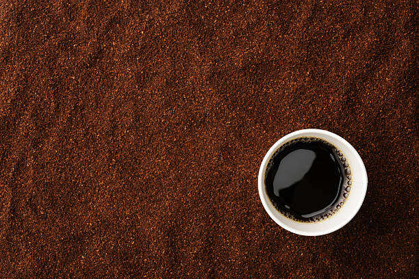 overhead shot of black coffee in disposable cup - paper coffee cup stock photos and pictures