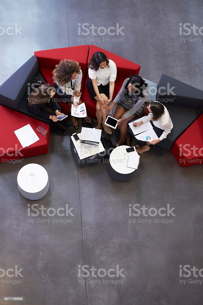 Overhead Shot Of Businesswomen Meeting In Lobby Of Office stock photo