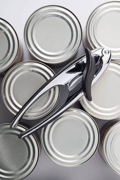Overhead Shot of Can Opener on Tin Cans - foto de stock