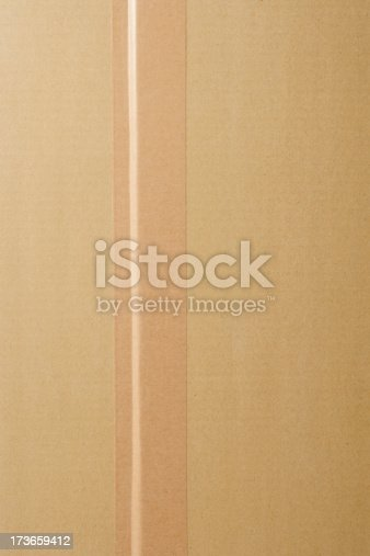 istock Overhead shot of cardboard box with adhesive tape 173659412