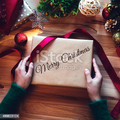 istock Overhead shot of Christmas presents and wrapping papers 499623124