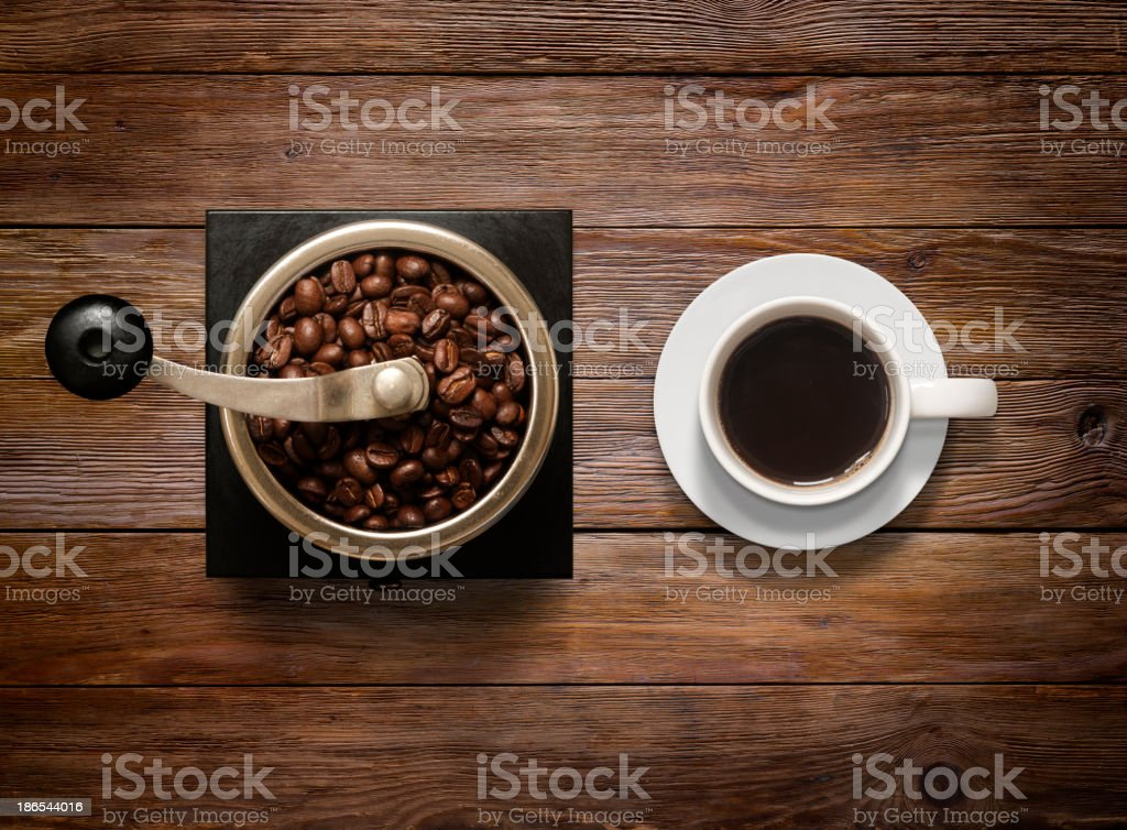 Overhead shot of Coffee Cup and Grinder on Wooden Background stock photo
