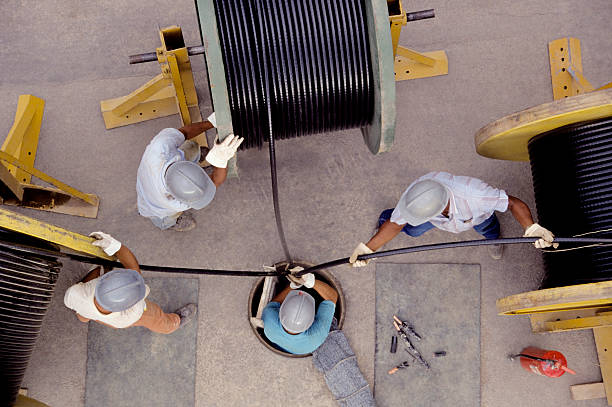 Overhead shot of electricians working  stock photo