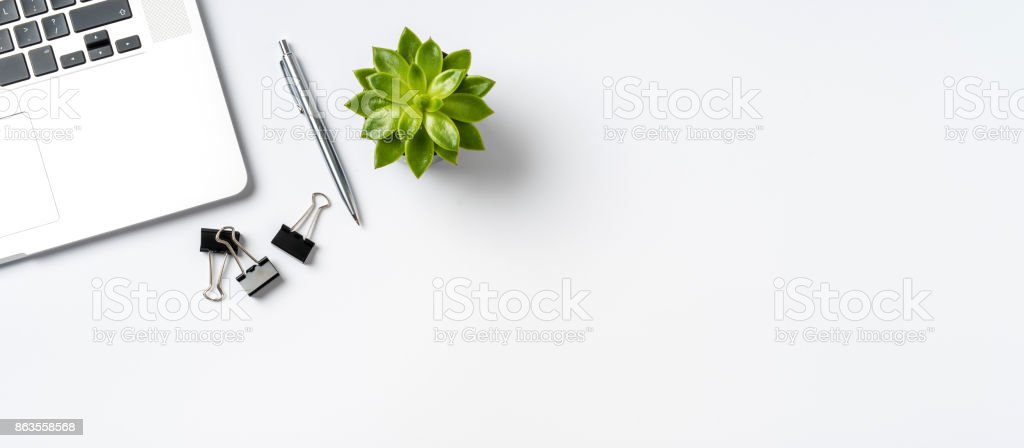 Overhead shot of office accessories on white background stock photo