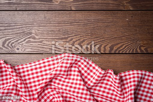 istock Overhead shot of red tablecloth on an old wooden table 670418188