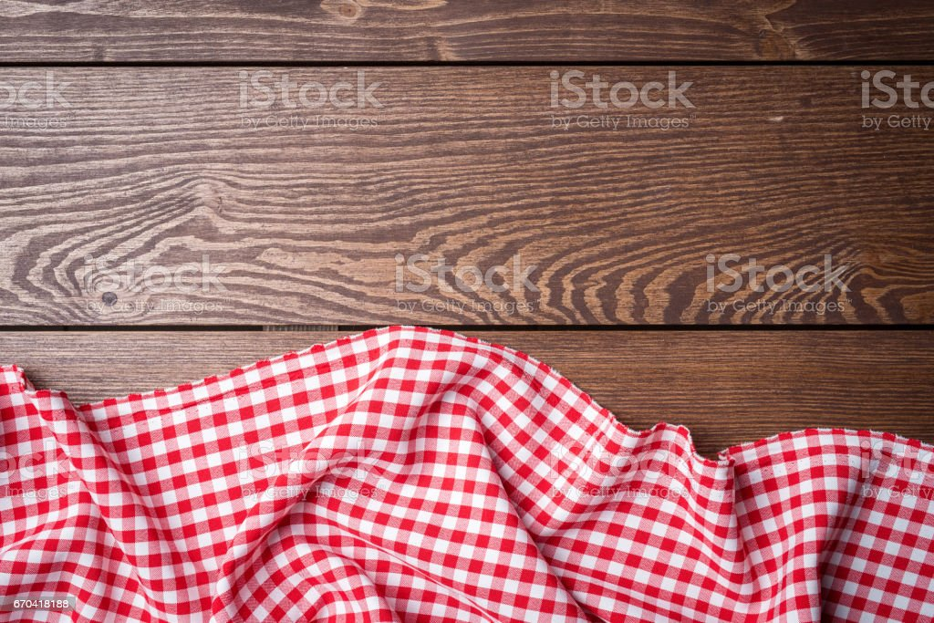 Overhead shot of red tablecloth on an old wooden table stock photo