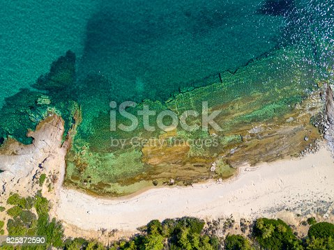 811600544 istock photo Overhead shot of sandy beach and turquoise sea 825372590