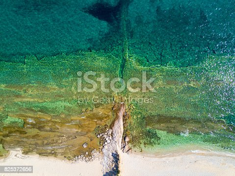 811600544 istock photo Overhead shot of sandy beach and turquoise sea 825372656