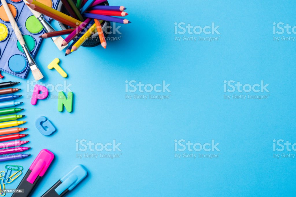 Overhead shot of school supplies on blue background royalty-free stock photo