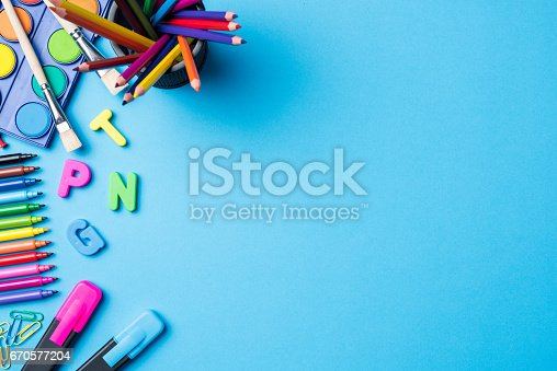 istock Overhead shot of school supplies on blue background 670577204