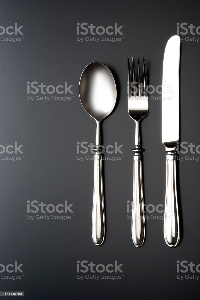 Overhead shot of silverware on black table with copy space royalty-free stock photo