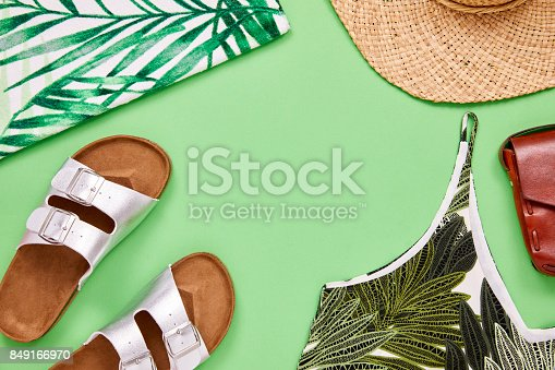 istock Overhead shot of top sandal sun hat and leather purse 849166970
