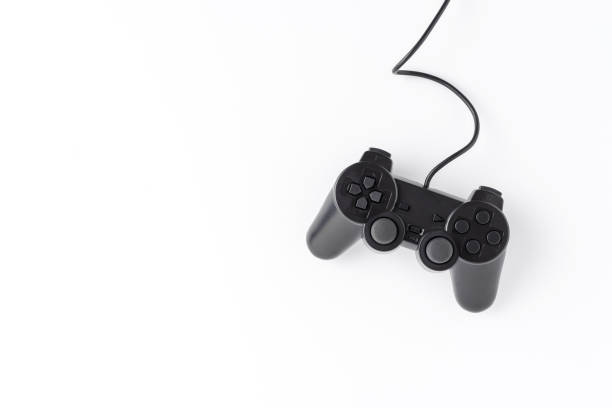 Overhead shot of video game controller isolated on white background with copyspace stock photo