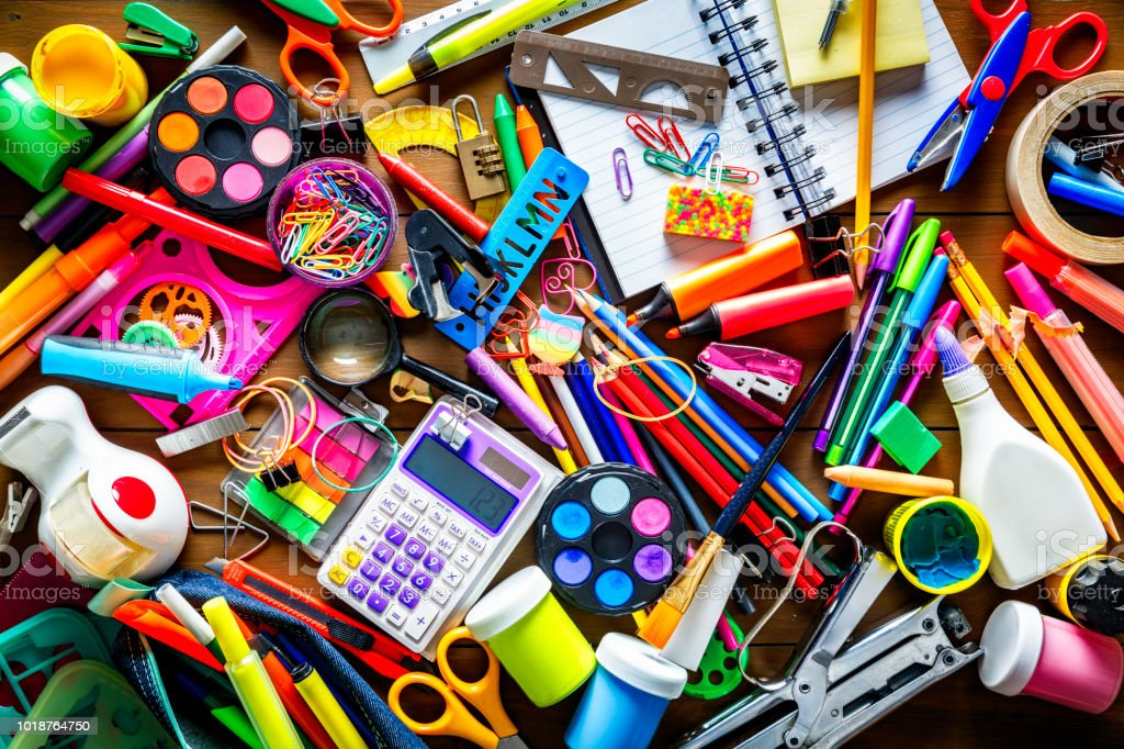 Overhead shot of wood table with back to school office supplies. Large group of objects. stock photo