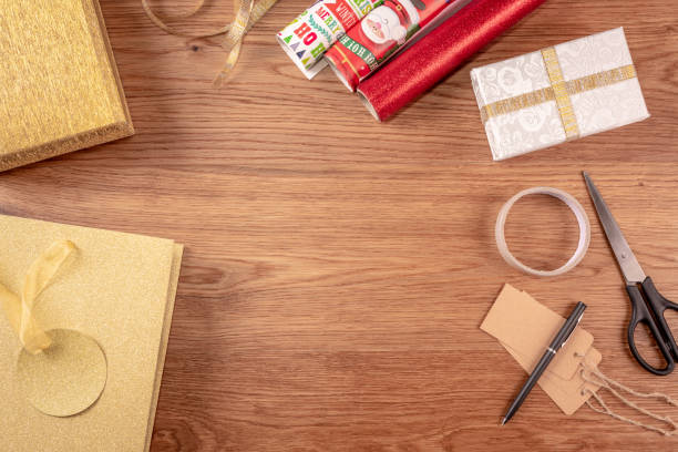 overhead shot of wrapping christmas presents - christmas stock photos and pictures