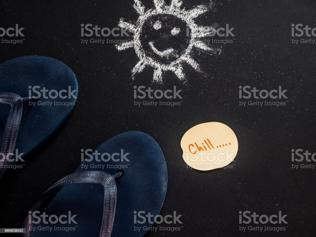overhead summer chill text on note paper sheet with flip flops and...