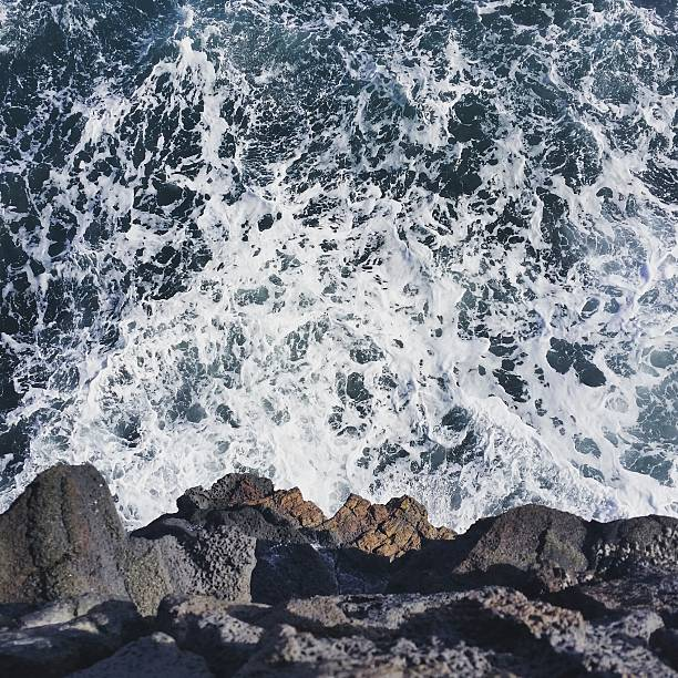 Overhead View Ocean and Rocky Cliff Volcano National Park Hawaii stock photo