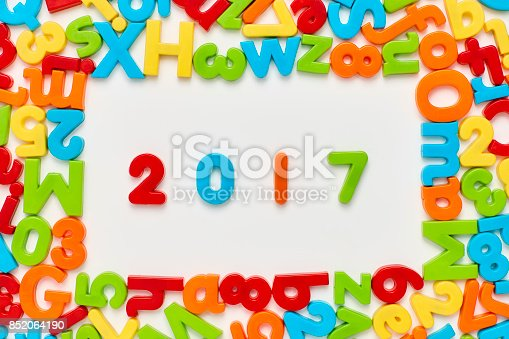 istock Overhead view of 2017 amidst multi colored alphabets and numbers 852064190