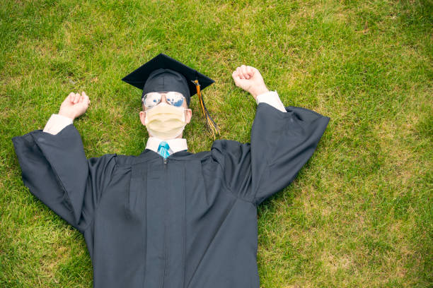 overhead view of 2020 graduate laying in grass - sdominick stock pictures, royalty-free photos & images