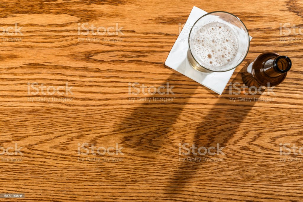 Overhead view of a beer, peanuts and pretzels on a bar stock photo