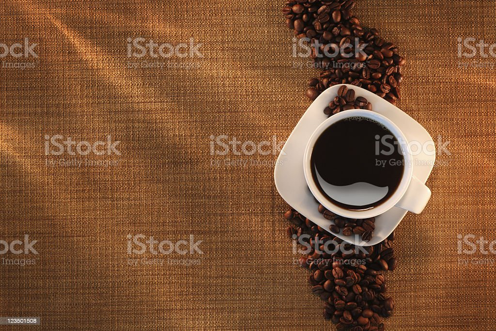 Overhead View of a Coffee Cup and Beans royalty-free stock photo