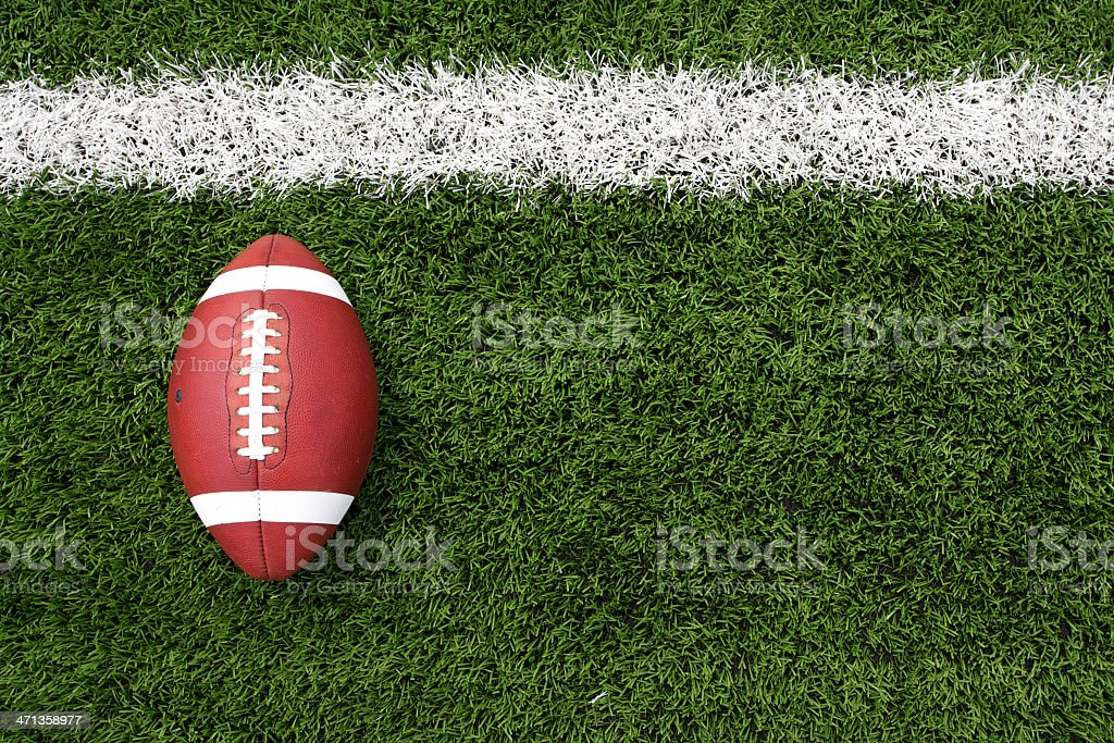 Overhead view of a football lying on a football field stock photo