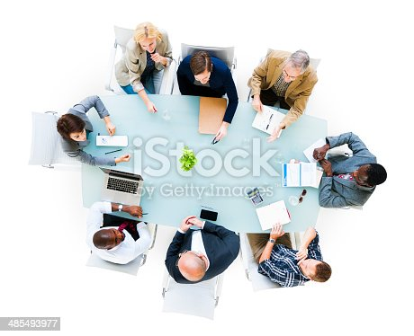 Overhead view of a group of business people at meeting.