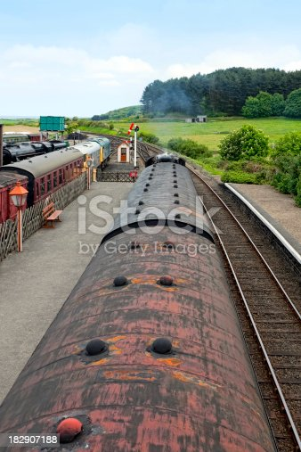 Colour-manipulated image of a steam train standing in a station - overhead view.