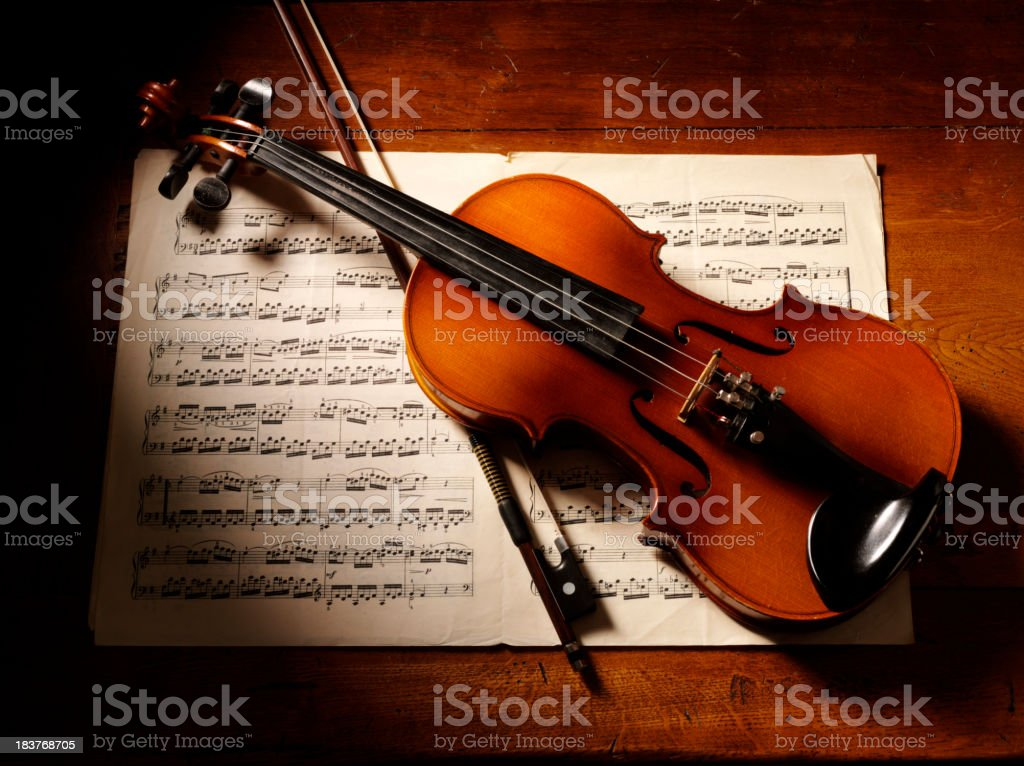 Overhead View of a Violin and Music stock photo