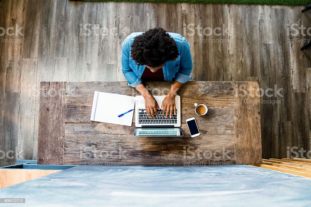 Overhead view of a woman using a computer - fotografia de stock