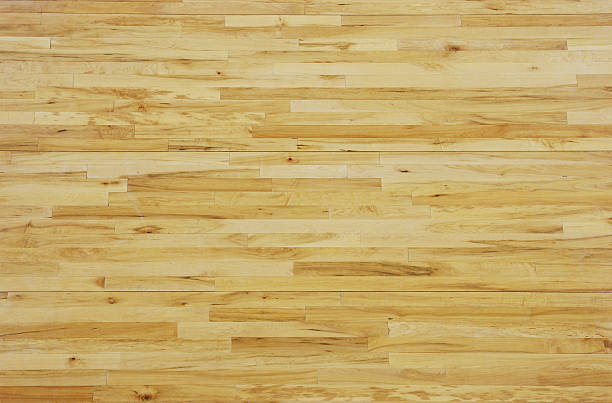 overhead view of a wooden basketball floor - speelveld stockfoto's en -beelden