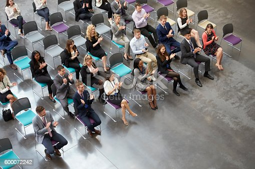 600073884 istock photo Overhead View Of Audience Applauding Speaker At Conference 600072242