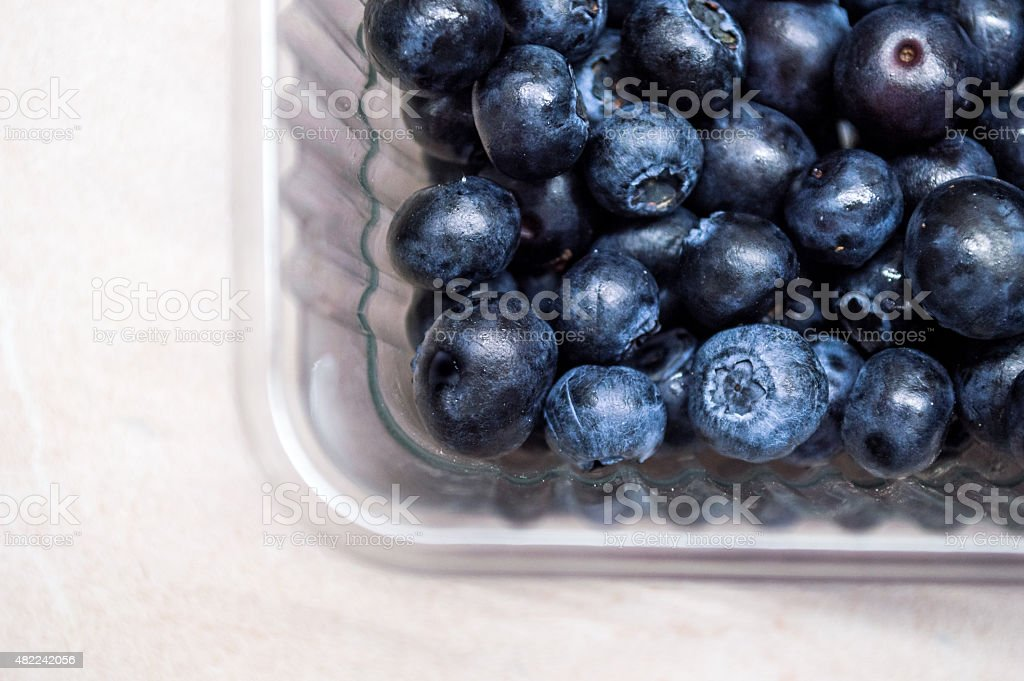 Overhead view of Blueberries in a Plastic Punnet royalty-free stock photo