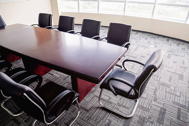 Overhead view of business conference room table in office Overhead view of business conference room table in office governing board stock pictures, royalty-free photos & images