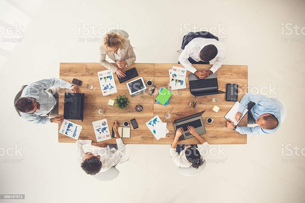 Overhead view of business meeting stock photo