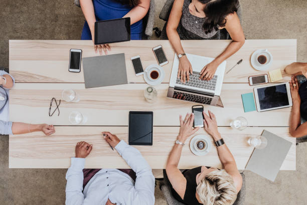 Overhead view of business meeting - foto stock