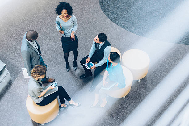 overhead view of business people in a meeting - bovenop stockfoto's en -beelden