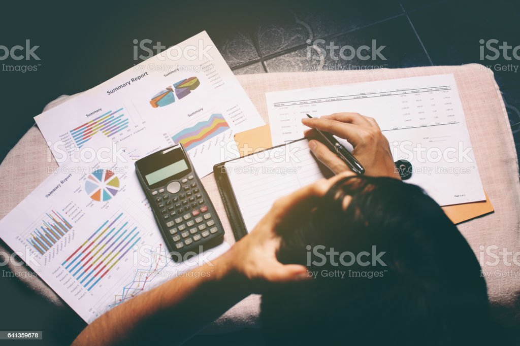 Overhead view of businessman stress in problem with expenses. stock photo