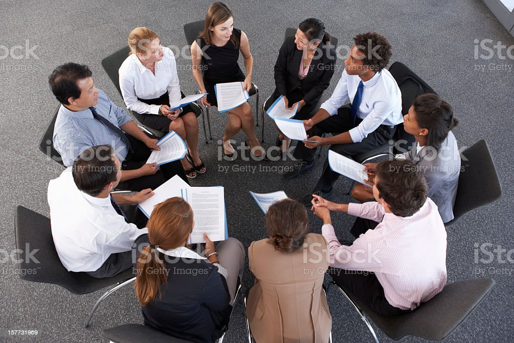Overhead View Of Businesspeople stock photo