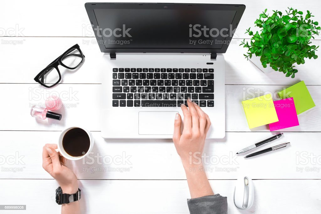 Overhead view of businesswoman working at computer in office stock photo