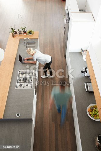 844050630 istock photo Overhead View Of Busy Couple In Modern Kitchen 844050512