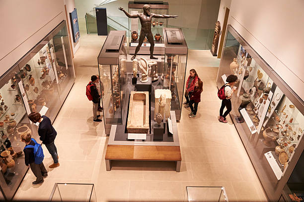 overhead view of busy museum interior with visitors - museum stockfoto's en -beelden
