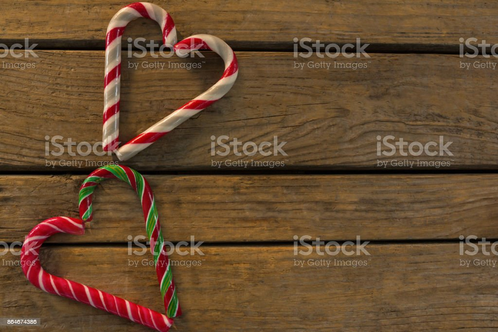 Overhead view of candy canes arranged in heart shape stock photo