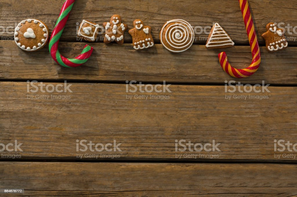 Overhead view of candy canes with gingerbread cookies arranged on table stock photo