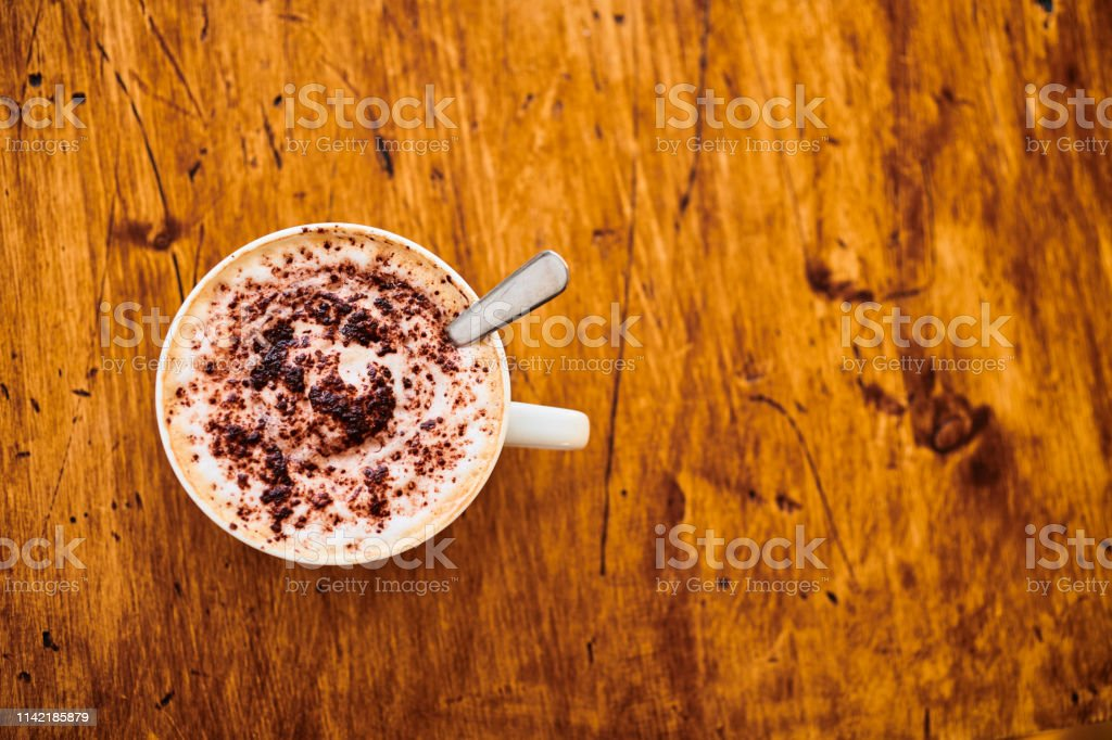 Overhead view of cappuccino coffee with room for copy. stock photo